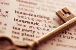 chiave del concetto di business per il team, il lavoro di squadra foto