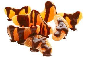 Mucchio di mandarino ricoperto di cioccolato foto