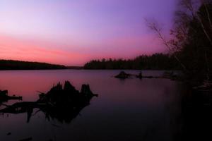 tramonto sul lago foto