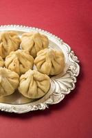 """ricetta sacra chiamata """"modak"""", dolce indiano foto"""