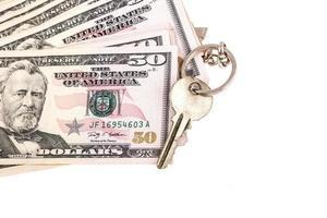 soldi e chiave foto