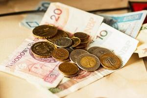 banconote e monete polacche dei soldi foto