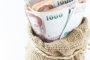 soldi nella borsa isolata foto