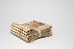 soldi brasiliani sul tavolo foto