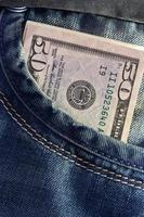 dollaro americano nella tasca dei jeans foto