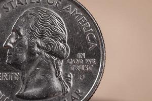 "noi moneta americana con scritta ""in god we trust"" foto"