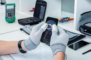 processo di riparazione del telefono cellulare foto