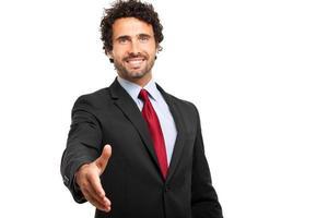 uomo d'affari che dà la sua mano foto