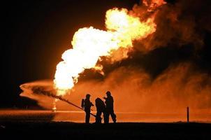 addestramento di esplosione del gas del pompiere foto