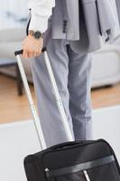 uomo d'affari con il suo bagaglio