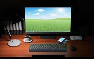 luogo di lavoro di notte con attrezzature per ufficio e accessori foto