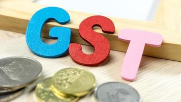 lettere dell'alfabeto fiscale gst o beni e servizi foto