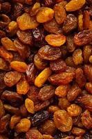 dieta cibo sano. uva passa secca uva come trama di sfondo foto