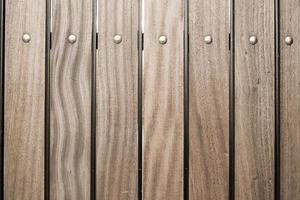 fondo di struttura della plancia di legno di legno di marrone scuro dell'annata foto