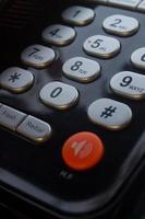 pulsante da vicino sul telefono fisso foto
