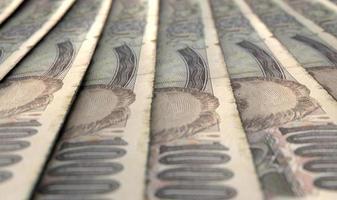 banconote del primo piano allineate foto