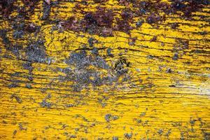 dipinto vecchio fondo di legno giallo della parete foto