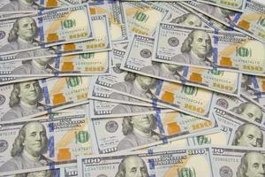 un mucchio di cento dollari come sfondo foto