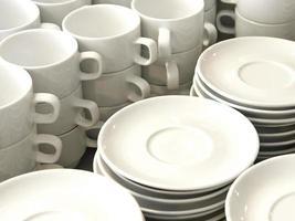tazze da caffè e piattini foto