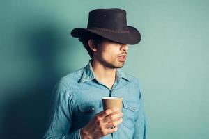 cowboy che beve caffè foto
