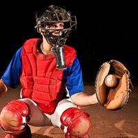 giocatore di baseball (catcher) a casa piastra foto
