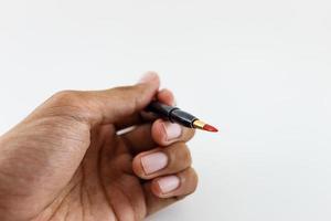 pennello rossetto su bianco foto