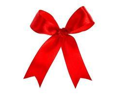 nastro rosso lucido su sfondo bianco con spazio di copia foto