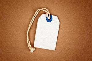 etichetta in bianco del prezzo da pagare di sconto in bianco come spazio della copia foto