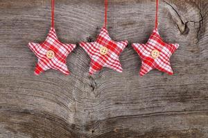 backgroun di legno rustico della decorazione di Buon Natale della stella rossa del tessuto foto