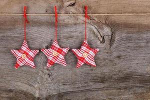 backgroun di legno rustico della decorazione di Buon Natale della stella rossa del tessuto