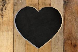amore San Valentino cuore cornice in legno nero lavagna bordo sfondo foto