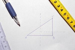 triangolo, penna e matematica foto