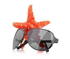 stella marina e occhiali da sole foto