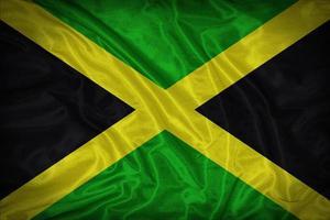 modello di bandiera della Giamaica sulla trama del tessuto, stile vintage foto