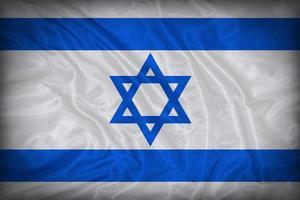 modello di bandiera di Israele sulla trama del tessuto, stile vintage foto