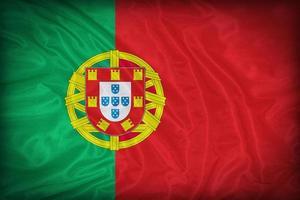 modello di bandiera del Portogallo sulla trama del tessuto, stile vintage foto