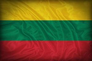 modello di bandiera della Lituania sulla trama del tessuto, stile vintage foto