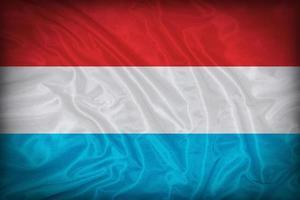 motivo a bandiera luxemborg sulla trama del tessuto, stile vintage foto