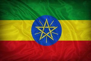 modello di bandiera Etiopia sulla trama del tessuto, stile vintage foto
