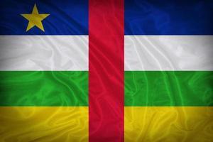 modello di bandiera Repubblica Centrafricana sulla trama del tessuto foto