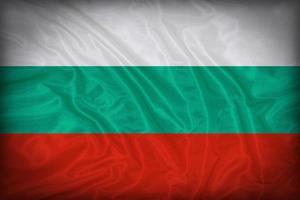 modello di bandiera bulgaria sulla trama del tessuto, stile vintage foto