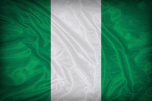 modello di bandiera nigeria sulla trama del tessuto, stile vintage foto