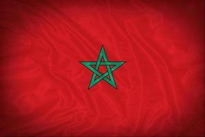 modello di bandiera del Marocco sulla trama del tessuto, stile vintage foto
