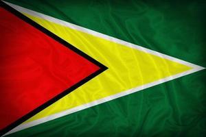 modello di bandiera Guyana sulla trama del tessuto, stile vintage foto