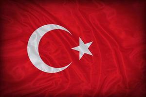 modello di bandiera Turchia sulla trama del tessuto, stile vintage foto
