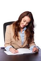 scrittura della donna di affari corporativi foto