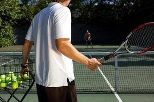 istruttore di tennis foto