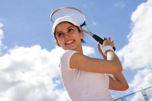 giocando a tennis foto