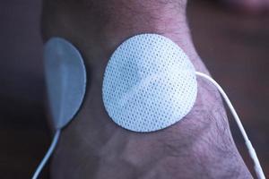 trattamento fisioterapico paziente braccio mano braccio foto