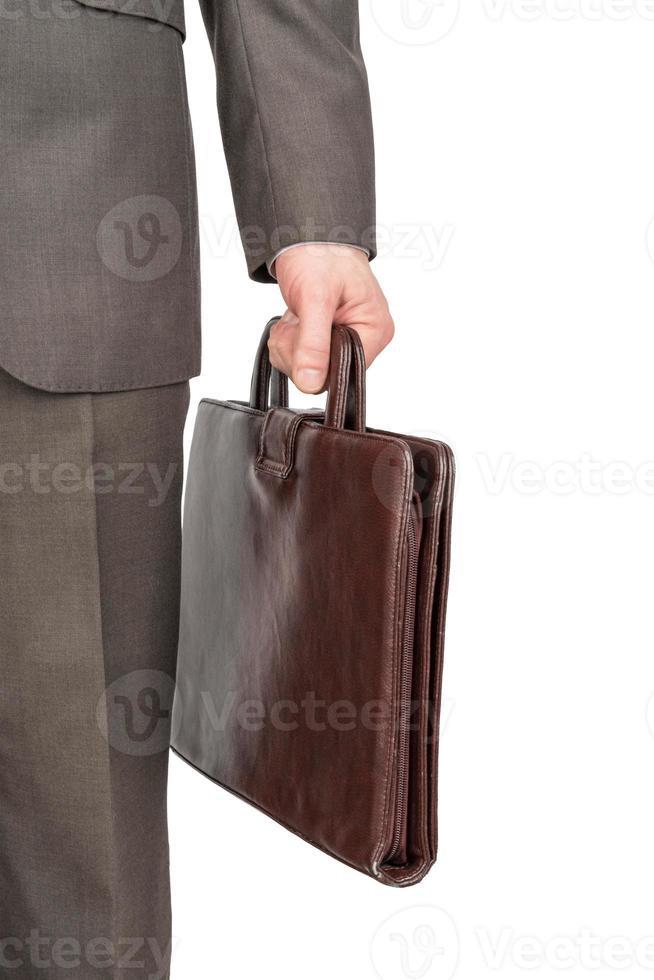 empresário com mala de couro, vista frontal foto
